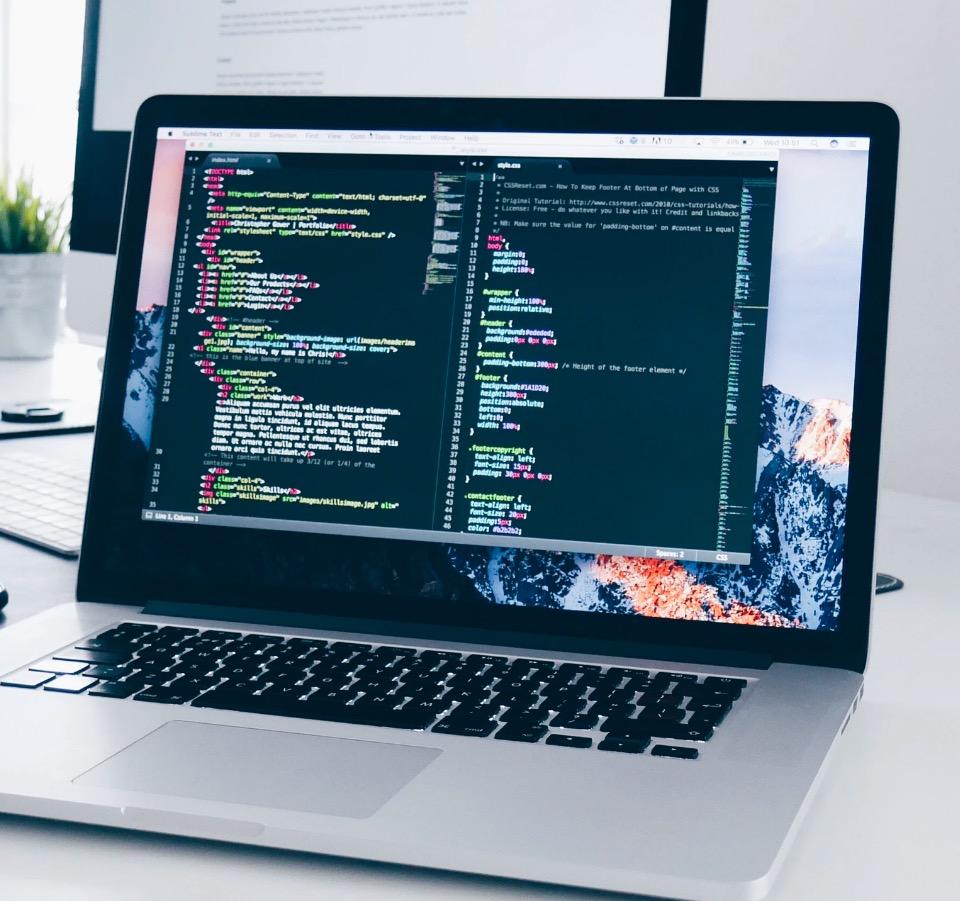 Laptop showing website development code